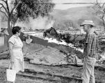 Mabel and Jim Sprague view Melody Ranch rubble