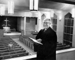 Rev. Elmer Ude inspects new sanctuary interior