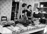 Tossed green salad, lasagne, hot hors d'oeuvres cover holiday decorated table in Hicks home