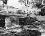 Worker cleans grave area at Calabasas pet cemetery