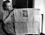 Mrs. Middleton shows off antique newspaper