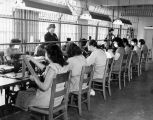 Sgt. Laura Churchill supervises sewing session in prison work room