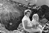 Mrs. Eldridge, Sunland, digs her own bomb shelter