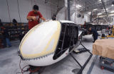 Installing helicopter windshields on the assembly line