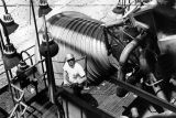 Worker stands near F-1 engine