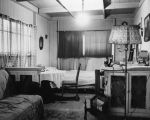 Interior view of three room home of Mary Tucker