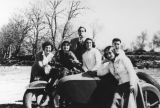 Friends around motorcycle with sidecar