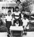 Japanese American children with birthday cake