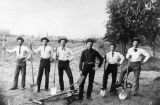 Men with shovels and plow