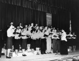 Frieta Shaw conducting choir at Hollywood High School