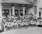 Group photo of African Americans in front of church