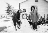 Mexican American woman with snowman