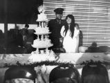Mexican American couple with wedding cake
