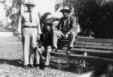 Mexican American men on park bench