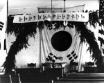 Interior of meeting hall decorated with Korean flag