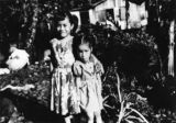 Samoan American girls in front yard