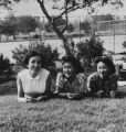 Three women relaxing on the grass