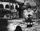 Child with puppy at San Fernando Mission