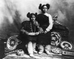 Hopi Indian girls in traditional dress and basketry