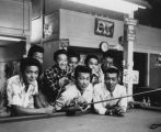 Japanese Americans in pool hall