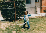 Girl playing with hoop toy