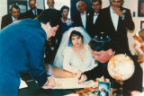 Couple signing wedding contract