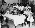 Large Iranian family at birthday party