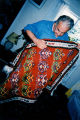 Ali Balali showing one of his Gelim rugs