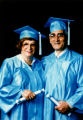 Elderly couple in cap and gown