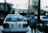 Ali Reza with car in driveway
