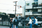 Korean Institute of Southern California students play basketball