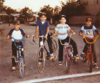 School friends on bikes