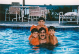 Father swimming with sons
