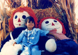 Rebecca with Raggedy Ann and Andy