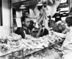 Shopping at the poultry counter