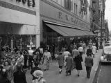 Pedestrians on Broadway near Woolworth's