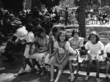 Children sitting on a park bench at the Plaza