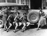 Creole girls pose on automobile