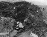 Man working in excavation of tar pit