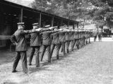 Line of officers with pistols
