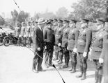 Will Rogers inspects the police officers