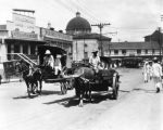 Two carriages on a Los Angeles street