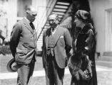 Louis B. Mayer chats with Sir Esme Howard and wife