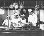 Jack Dempsey and cooks in restaurant