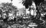 Men sitting on benches at the Plaza park