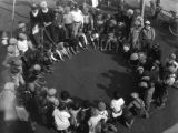 Children playing marbles, view 6