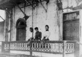 Women on Pio Pico mansion balcony