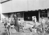 Teacher and her students, Corona Avenue School