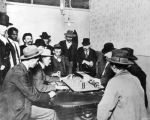 Gamblers seated at gaming table