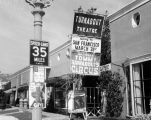 Signs in front of Turnabout Theatre in 1956, one announcing their impending move to San Francisco...